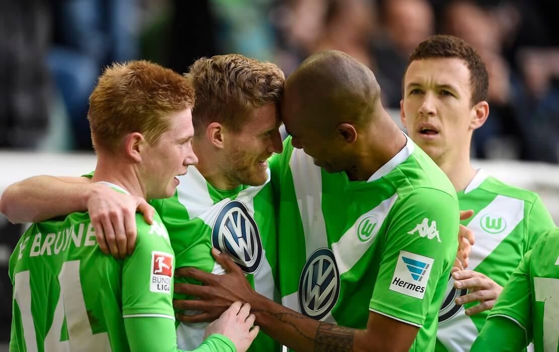 Wolfsburg Spieler De Bruyne, Schürrle, Naldo und Perisic jubeln