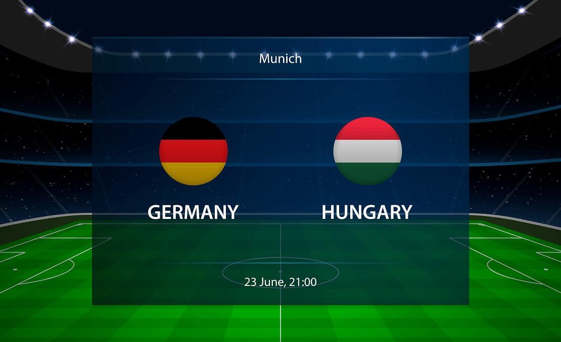 Die Flaggen von Deutschland und Ungarn vor einem virtuellen Stadion